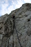 Climber above ladder on Pittentaler Klettersteig Stock Images