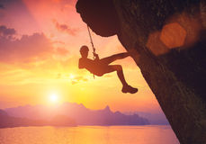Climber against red sunset Royalty Free Stock Photos