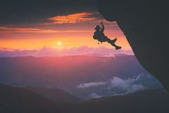 Climber against sunset background. Instagram stylisation Stock Image