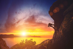 Climber against sunset Royalty Free Stock Photography