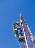 Climber on antenna tower Royalty Free Stock Photo