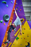Climber On Artificial Climbing Wall In Bouldering Gym Without In Royalty Free Stock Photos