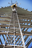Climber ascending cell phone tower Royalty Free Stock Photography