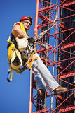 Climber ascending cell tower Stock Images