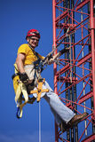 Climber ascending the cellular tower Royalty Free Stock Images