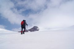 Climber on ascent. Climber ascends to the top of the glacier Stock Photo