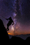 Climber on a background of the starry sky. Climber Silhouette on a background of the starry sky royalty free stock images