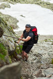 Climber with backpack Stock Photography