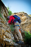 Climber with backpack Stock Image