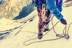 Climber reaches the summit of mountain peak. Succes Royalty Free Stock Photo