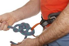 Climber is binding Stock Photo