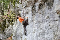 Climber is bouldering Royalty Free Stock Photo