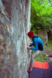 Climber is bouldering outdoors. Stock Image