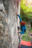 Climber is bouldering outdoors. Royalty Free Stock Images