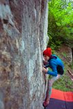 Climber is bouldering outdoors. Royalty Free Stock Photos