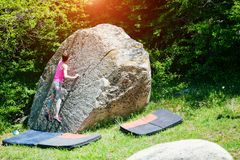 Climber is bouldering outdoors. Stock Photos