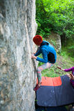 Climber is bouldering outdoors. Stock Images