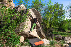 Climber is bouldering outdoors. Stock Photography