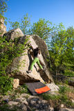 Climber is bouldering outdoors. Royalty Free Stock Photo