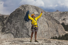 Climber celebrates on the summit. Stock Photo