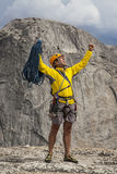 Climber celebrates on the summit. Stock Photos