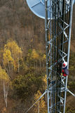 Climber on cell tower Stock Photos