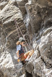 Climber chalks up. Stock Images