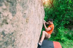 The climber is climbing bouldering. Royalty Free Stock Image