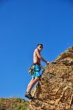 Climber climbing with carbines Royalty Free Stock Photo
