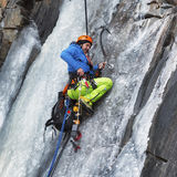 Climber climbing ice wall in montain Royalty Free Stock Photos