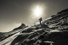 Climber climbing on an icy hill Royalty Free Stock Photo