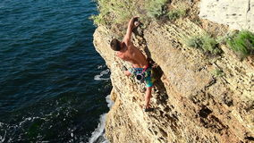 Climber Climbing On A Rock stock video