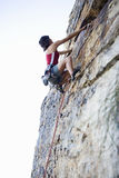 A climber climbing a rock face Royalty Free Stock Photos