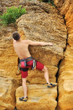 Climber climbing on rock Stock Photos