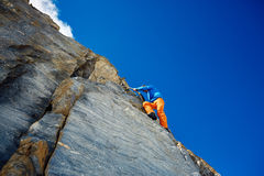 Climber climbing up a cliff Royalty Free Stock Image