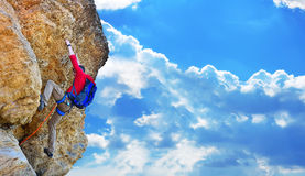 Climber climbing up Stock Photo