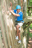 Climber in climbing wall at high rope course Royalty Free Stock Photo