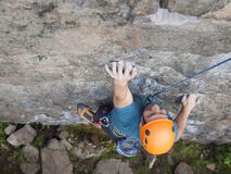 The climber climbs in the helmet on the wall. Royalty Free Stock Images