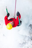 The climber climbs on ice. Royalty Free Stock Images
