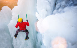 The climber climbs on ice. Royalty Free Stock Image