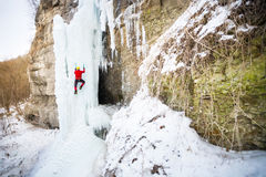 The climber climbs on ice. Stock Photos