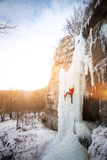The climber climbs on ice. Stock Image