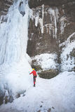 The climber climbs on ice. Royalty Free Stock Photography
