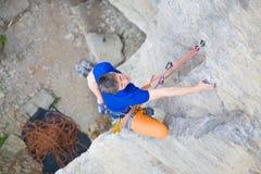 Climber climbs the rock. Royalty Free Stock Photography