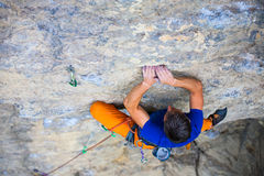 Climber climbs the rock. Royalty Free Stock Image