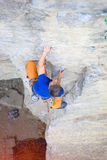 Climber climbs the rock. Royalty Free Stock Images