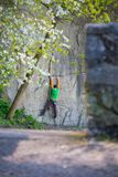 Climber climbs on the rock. A man goes in for sports in the fresh air. The athlete climbs on the boulder Royalty Free Stock Photo