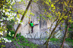 Climber climbs on the rock. Royalty Free Stock Image