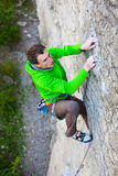 Climber climbs the rock. Stock Photo