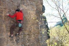Climber climbs the rock. Royalty Free Stock Photos